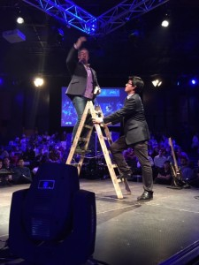 Michael preaches from a great height with his spanish interpreter at Transcendia'15, Lima Peru